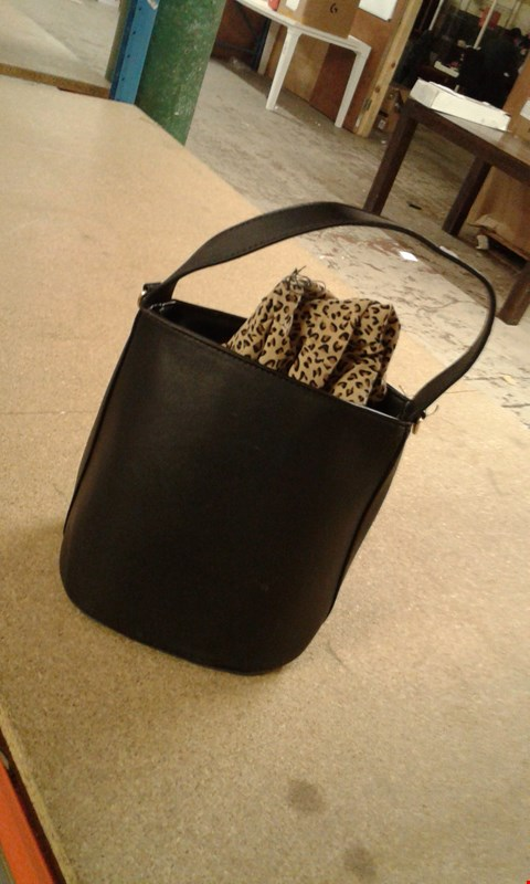 Lot 65 BOX OF APPROXIMATELY 12 BLACK LEATHER HANDBAGS WITH INNER LEOPARD PRINT MINI SACK FEATURE