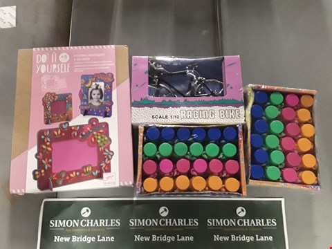 Lot 763 LOT OF 4 ASSORTED ITEMS TO INCLUDE 2 PACKS OF BUBBLE MAGIC, DO IT YOURSELF PHOTO FRAME SET AND A MODEL RACING BIKE