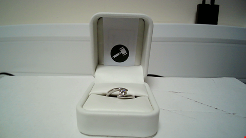 Lot 25 18CT WHITE GOLD TWIST RING SET WITH A DIAMOND WEIGHING +0.59CT RRP £3900.00
