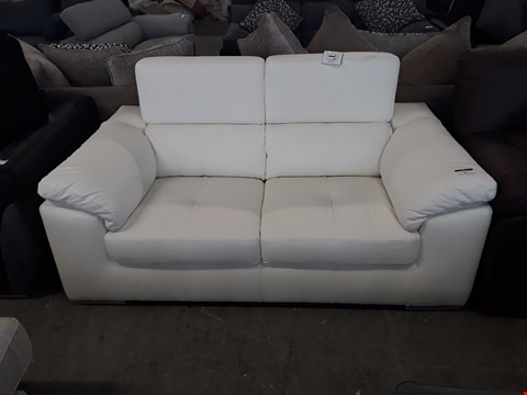 Lot 77 DESIGNER IVORY LEATHER 2 SEATER SOFA WITH ADJUSTABLE HEADRESTS