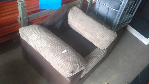 Lot 310 FAUX BROWN LEATHER AND JUMBO CORD ARMCHAIR