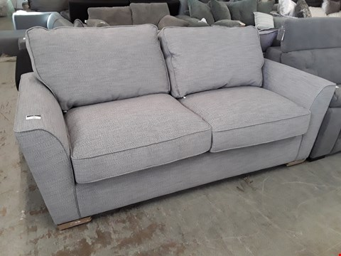 Lot 79 DESIGNER GREY FABRIC THREE SEATER SOFA