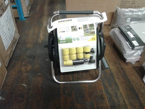 Lot 1661 A BOXED WALL MOUNTED HOSE REEL