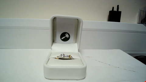 Lot 22 18CT GOLD RING SET WITH A PRINCESS CUT DIAMOND WITH DIAMONDS SET SHOULDERS RRP £1875.00