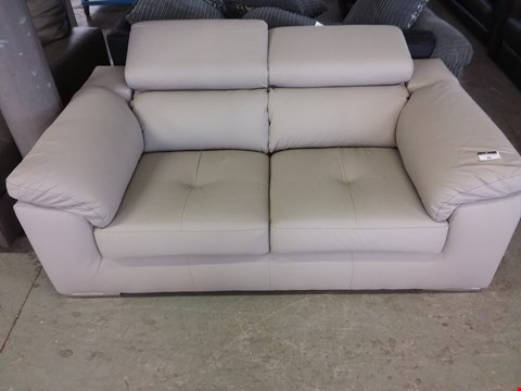 Lot 36  DESIGNER CREAM FAUX LEATHER 2 SEATER SOFA