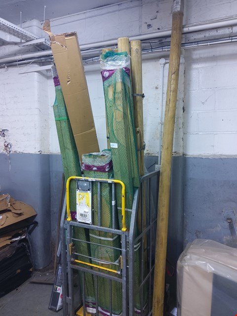 Lot 609 CAGE OF SWING SET PARTS/POLES