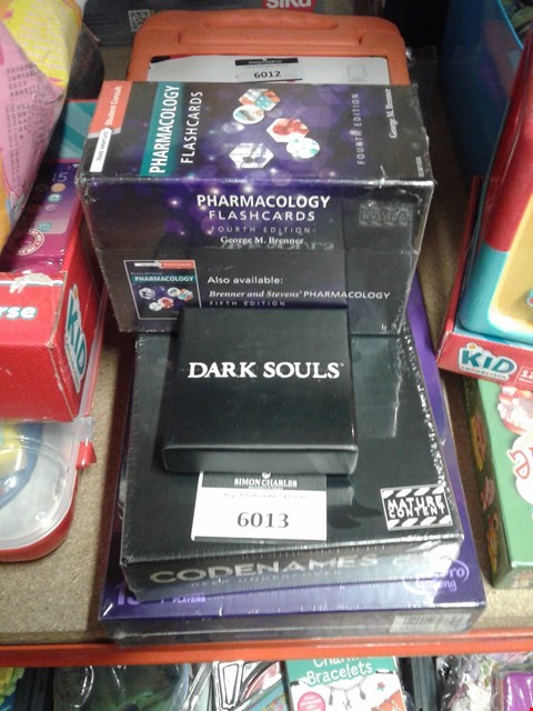 Lot 6013 Lot of 4 items to include - dark souls pins - codenames game - pharnacology flash cards -
