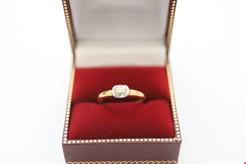 Lot 20 18CT GOLD RING WITH A SEMI-RUBOVER SET DIAMOND WEIGHING +-0.73CT