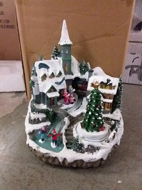 Lot 2099 LOT OF 3 SEASONAL ITEMS TO INCLUDE MUSICAL CHRISTMAS VILLAGE SCENE AND CANDY CANE STAKE LIGHTS (3 BOXES) RRP £118