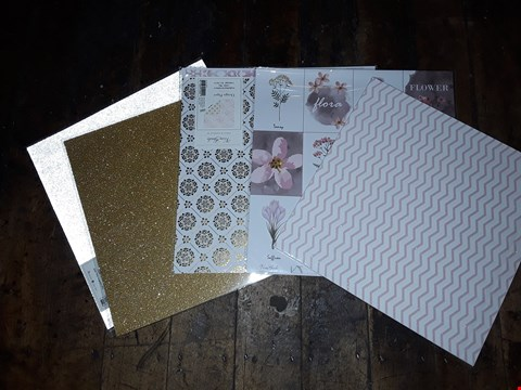 Lot 501 LOT OF APPROXIMATELY 10 PACKS OF DESIGNER CRAFT PAPER