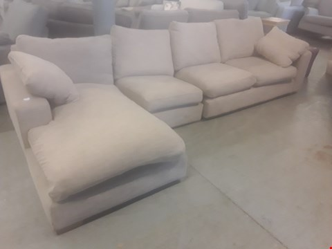 Lot 86 QUALITY BRITISH DESIGNER BEIGE FABRIC LARGE CHAISE SOFA WITH BOLSTER CUSHIONS