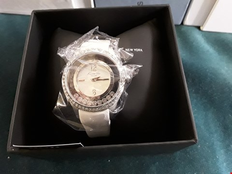 Lot 62 DESIGNER KENNETH COLE NEW YORK LADIES WRIST WATCH WITH ENCRUSTED DIAL ON WHITE LEATHER STRAP