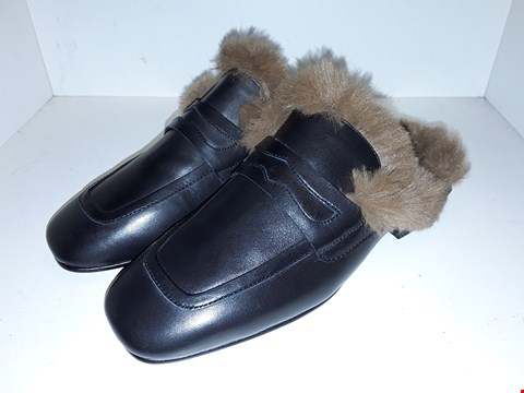 Lot 1007 A PAIR OF EMOTION ECO FUR SLIP ON SHOES UK SIZE 7
