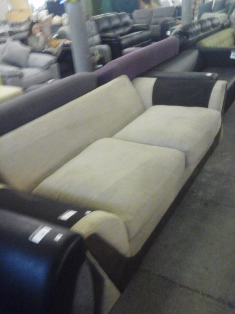 Lot 688 DESIGNER BEIGE AND BROWN FABRIC 3 SEATER SOFA