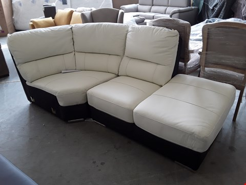 Lot 103 TWO DESIGNER TWO TONE CREAM AND BLACK FAUX LEATHER SOFA SECTIONS