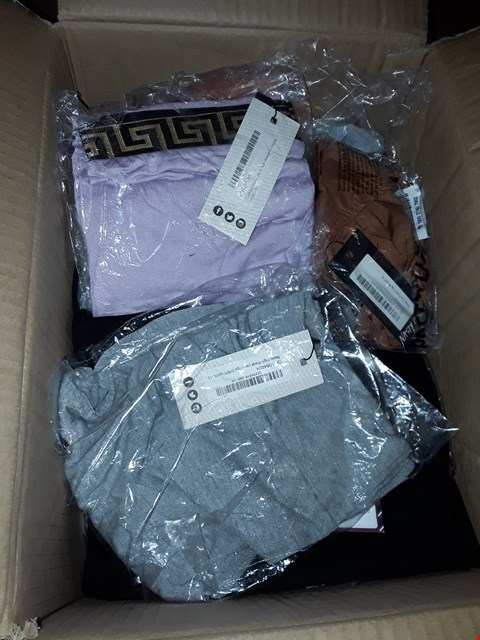 Lot 77 LOT OF APPROXIMATELY 20 CLOTHING ITEMS FROM BOOHOO, MISGUIDED AND PRETTY LITTLE THING