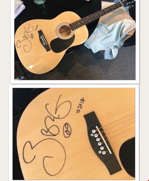 Lot 20 SIGNED ACOUSTIC GUITAR DONATED BY SIR BOB GELDOF