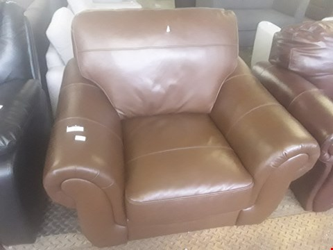 Lot 31 DESIGNER BROWN FAUX LEATHER ARMCHAIR