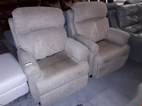 Lot 24 PAIR OF QUALITY BRITISH MANUFACTURED HARD WOOD FRAMED BEIGE FABRIC POWER RECLINING EASY CHAIRS