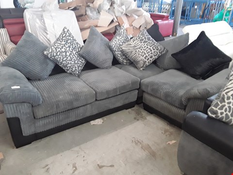 Lot 92 DESIGNER BLACK FAUX LEATHER AND GREY JUMBO CORD CORNER SOFA WITH SCATTER BACK CUSHIONS