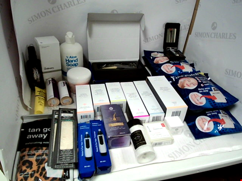 Lot 11027 LOT OF ASSORTED HEALTH & BEAUTY PRODUCTS TO INCLUDE: DRUNK ELEPHANT ASSORTED SERUMS & CREAMS, ELECTRIC HAIR CLIPPER, SAFETY RAZOR WITH BLADES, ASSORTED BATHROOM & MAKEUP PRODUCTS