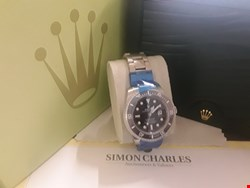 Lot 24 BOXED OYSTER PERPETUAL SUBMARINER WRIST WATCH