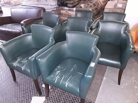 Lot 12120 SET OF SEVEN GREEN FAUX LEATHER UPHOLSTERED ARMCHAIRS