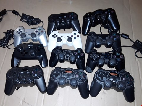 Lot 174 LOT OF APPROXIMATELY 11 ASSORTED PS4 & PS2 GAMING CONTROLLERS