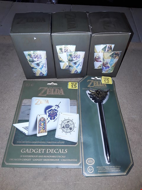Lot 2206 LOT OF 5 ASSORTED THE LEGEND OF ZELDA ITEMS TO INCLUDE HYRULE COLOUR CHANGE GLASS, GADGET DECALS, HYRULE PEN & PEN TOPPER