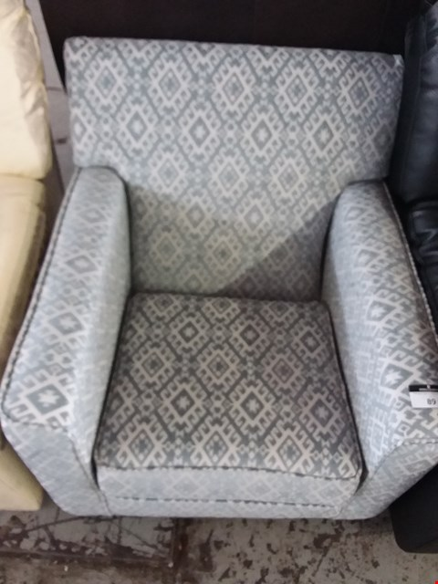 Lot 89 DESIGNER MINT AND WHITE PATTERNED FABRIC CHAIR