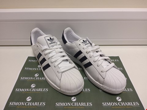 Lot 3035 PAIR OF ADIDAS WHITE TRAINERS SIZE 12