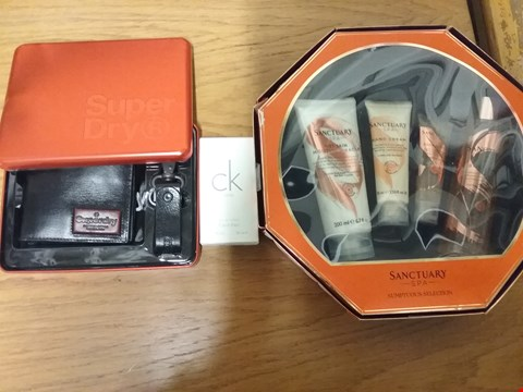 Lot 7116 BOX OF APPROXIMATELY 14 GRADE 1 HEALTH AND BEAUTY ITEMS TO INCLUDE CALVIN KLEIN CK ONE 50ML EAU DE TOILETTE, SUPERDRY SUPER JACKSON GIFT SET AND SANCTUARYS SCRUMPTIOUS SELECTION RRP £236
