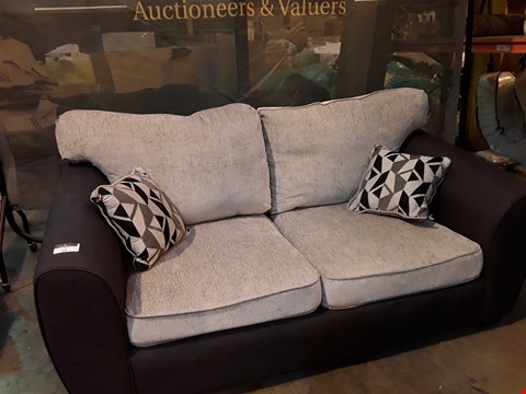 Lot 12 DESIGNER LIGHT/DARK GREY FABRIC TWO SEATER SOFA WITH SCATTER CUSHIONS
