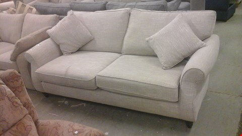Lot 1243 DESIGNER BEIGE FABRIC 3 SEATER SOFA