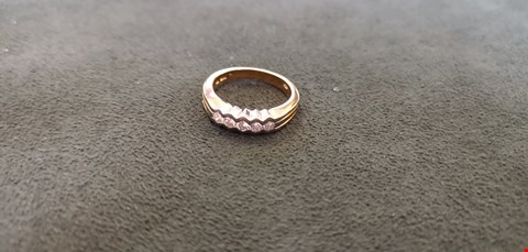 Lot 69 18CT GOLD HALF ETERNITY RING RUB OVER SET WITH DIAMONDS WEIGHING +0.37CT  RRP £2400.00