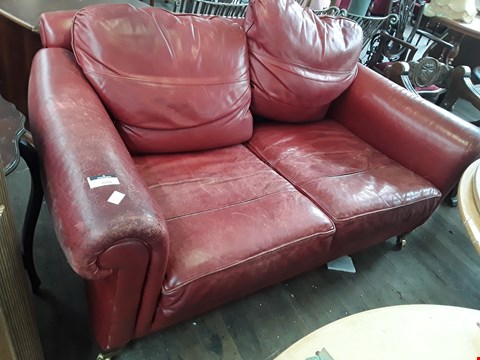 Lot 5009 DESIBNER RED LEATHER THREE SEATER SOFA ON BRASS CASTORS