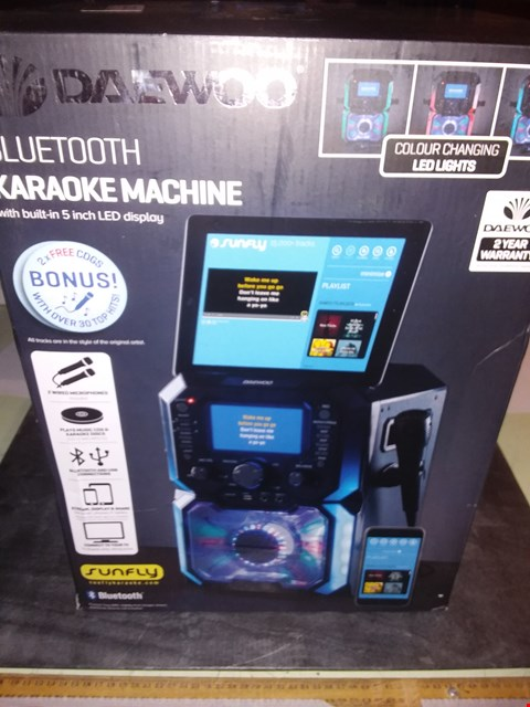 Lot 1733 DAEWOO BLUETOOTH PORTABLE KARAOKE MACHINE WITH 2 WIRED MICROPHONES, 5 INCH DIGITAL LCD DISPLAY SCREEN, 3.5MM AUX INPUT, CD, MP3, USB CONNECTION, LED LIGHTS & 2 MIC IN JACKS - BLACK