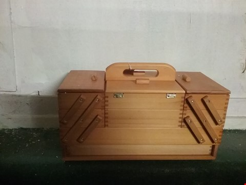 Lot 1173 HOBBYGIFT WOOD CANTILEVER SEWING BOX: 4 TIER, ASSORTED, 23.5 X 45 X 32 CM