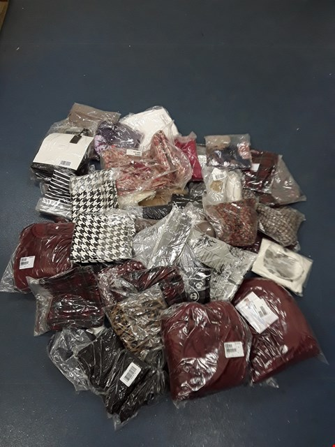 Lot 511 LOT OF APPROXIMATELY 46 ASSORTED DESIGNER CLOTHING ITEMS TO INCLUDE FLORAL HOODIE, TROUSERS, POLKA DOT DRESS ETC