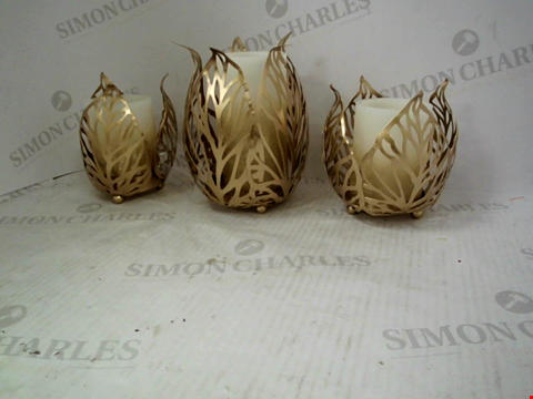 Lot 1310 A ALISON AT HOME GOLD 3 ELECTRIC CANDLE SET