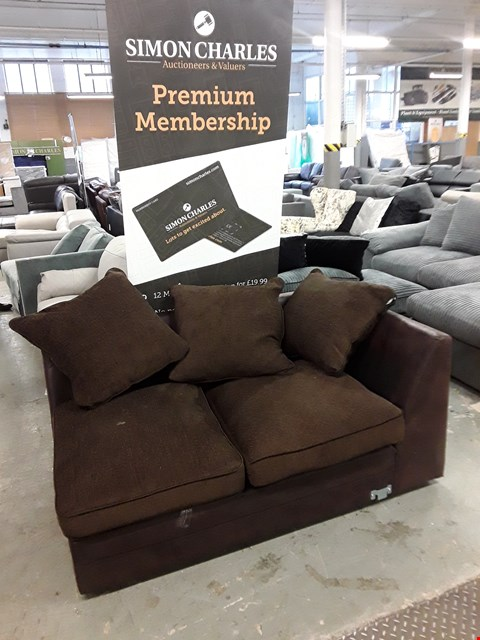 Lot 35 DESIGNER BROWN FAUX LEATHER SOFA SECTION WITH MISMATCHED SCATTER CUSHIONS