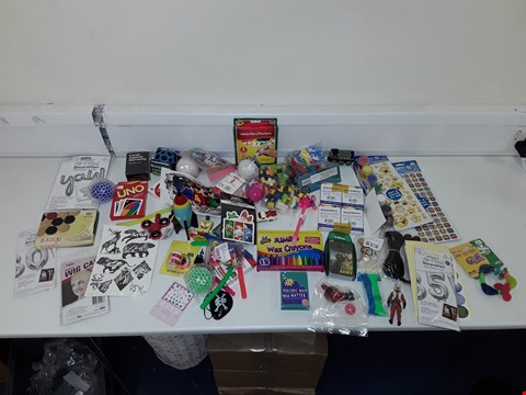 Lot 7202 LOT OF A LARGE QUANTITY OF ASSORTED TOY ITEMS TO INCLUDE JUMBO WAX CRAYONS, UNO, CARDS AGAINST HUMANITY THIRD EXPANSION, TOP TRUMPS, ETC