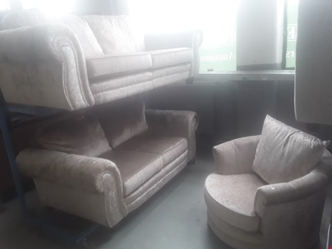 Lot 87 DESIGNER LUNA ROSE CRUSHED VELVET SUITE WITH STUDDED SCROLL ARMS, COMPRISING THREE & TWO SEATER SOFAS & SWIVEL SNUGGLE CHAIR