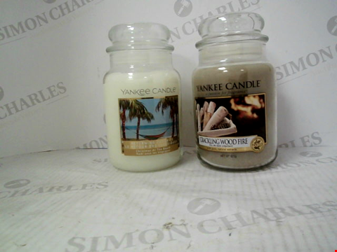 Lot 1341 1 LARGE JAR CHRISTMAS AT THE BEACH CANDLE AND A LARGE JAR CRACKLING WOOD FIRE CANDLE.