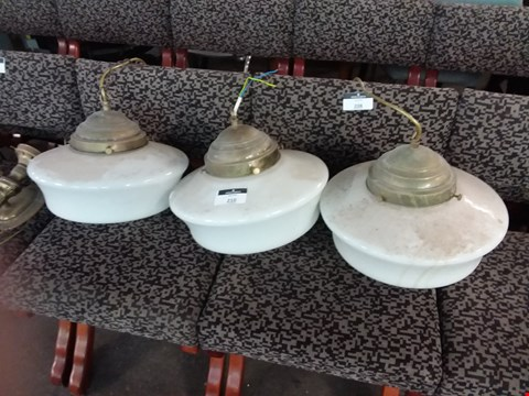 Lot 210 LOT OF 3 VINTAGE BRASS AND WHITE CERAMIC PENDANT LIGHTS