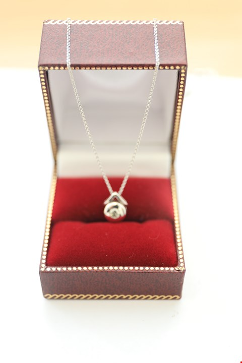 Lot 23 18CT WHITE GOLD PENDANT ON CHAIN RUBOVER SET WITH A DIAMOND WEIGHING +-0.13CT