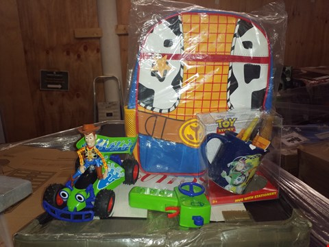 Lot 487 GRADE 1 TOY STORY WOODY JUNIOR BACKPACK AND MUG WITH STATIONARY AND WOODY RC TURBO BUGGY RRP £57.00