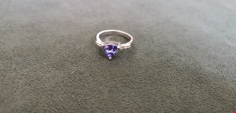 Lot 79 18CT WHITE GOLD RING SET WITH A TRILLIANT CUT TANZANITE AND DIAMONDS TO SHOULDERS TOTAL WEIGHT +1.53CT  RRP £3740.00
