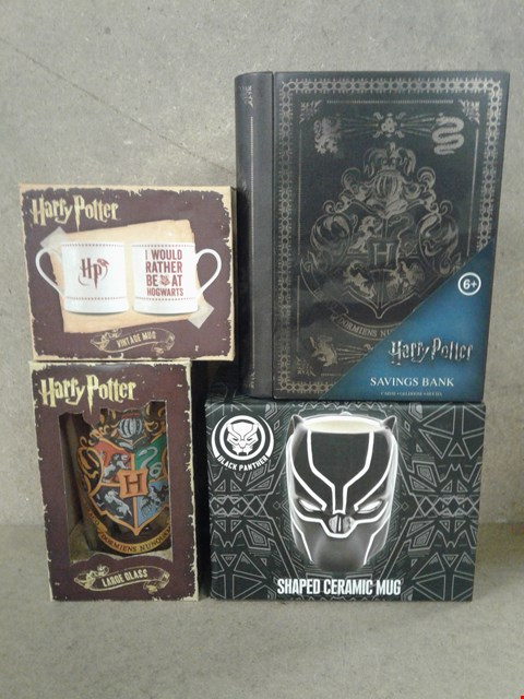 Lot 488 4 BRAND NEW BOXED ITEMS TO INCLUDE HARRY POTTER MUG , LARGE GLASS , SAVINGS BANK AND BLACK PANTHER SHAPED CERAMIC MUG