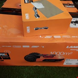 Lot 146 WORX LANDROID M1000 CORDLESS ROBOTIC LAWNMOWER AND OBSTACLE AVOIDANCE ACCESSORY  RRP £1100.00